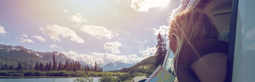 Mountain lake landscape and Young Woman in Canada